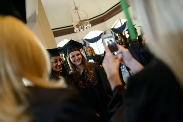 Two P-A students pose for a picture in their graduation gowns