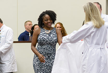 Student receives white coat