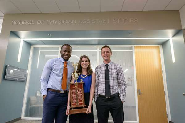 UF PA students Olatunde Oshikoya, Jessica Buchko and Kyle Proffitt with trophy