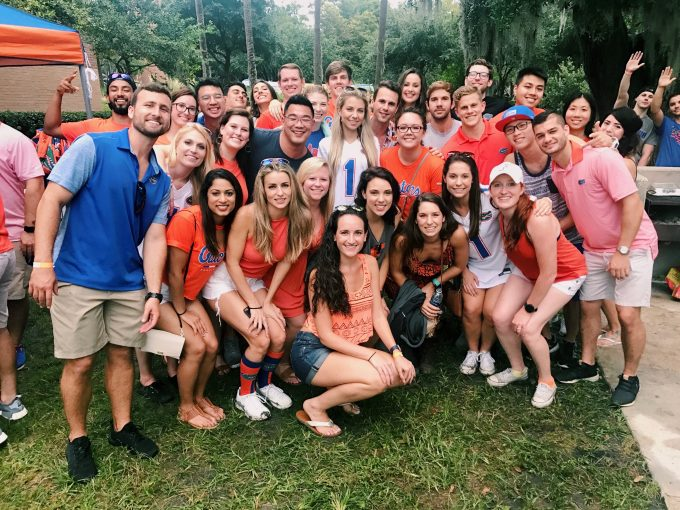A large group of P-A students pose for a photo wearing orange and blue, Gator-themed clothing