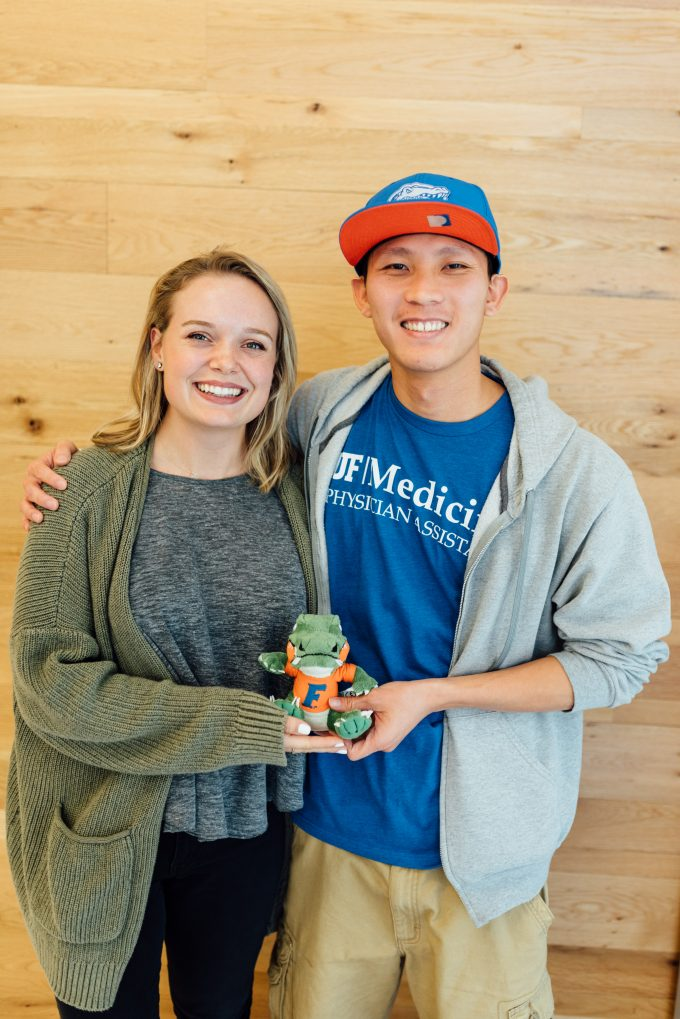 Two P-A students pose for a photo with a small Albert mascot stuffed animal