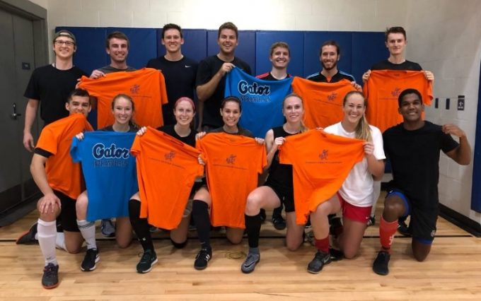 Students pose for a photo holding their intramural T-shirts