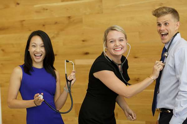 Three students with stethoscopes